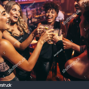 stock-photo-group-of-friends-partying-in-a-nightclub-and-toasting-drinks-happy-young-people-with-cocktails-at-576162352